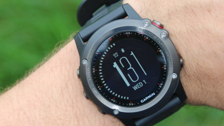 Man looking at his Garmin Fenix 3 GPS watch