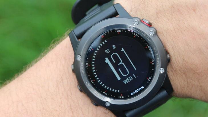 Man looking at his Garmin Fenix 3 GPS watch