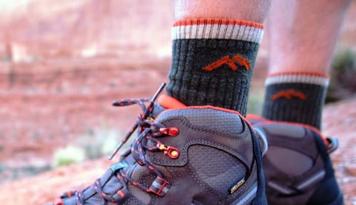 Close-up image of a hiker's legs while wearing socks