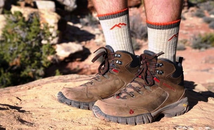 Hiker wearing warm socks with his boots
