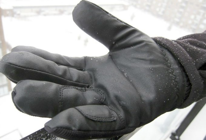 Image of a man wearing waterproof-winter-gloves