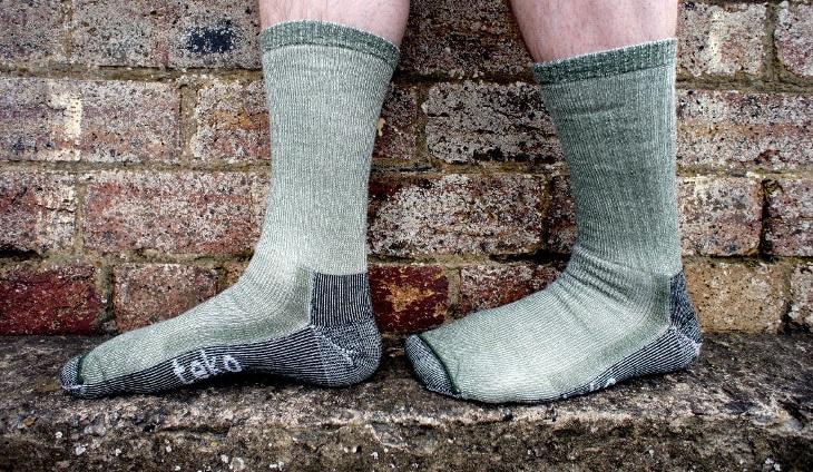 A man walking in outdoor socks