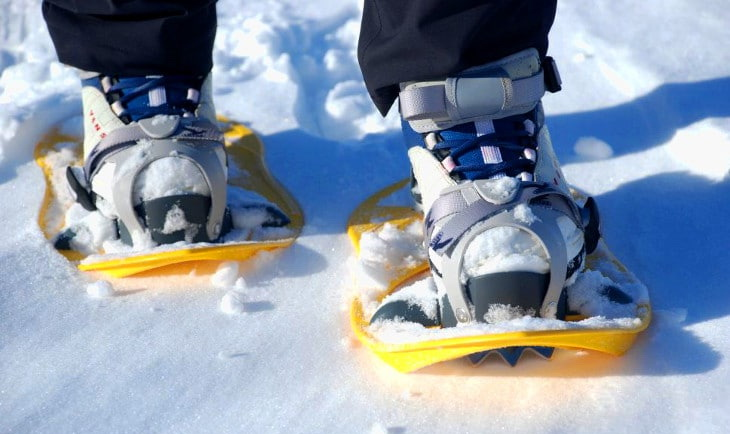 A person walking in a pair of snowboots