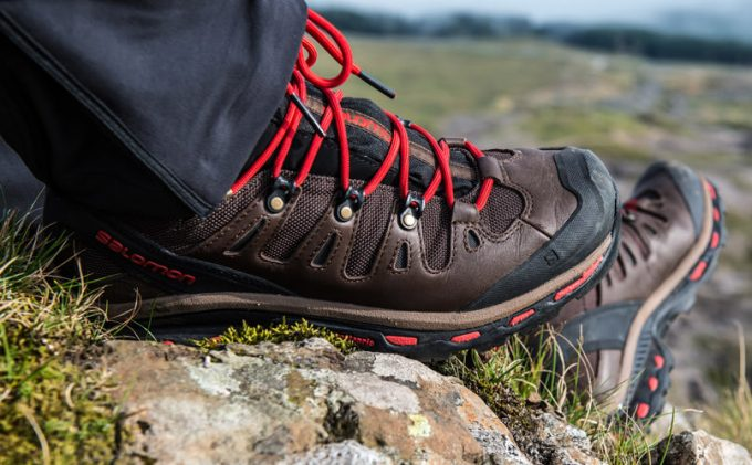 A man hiking in Salomon hiking boots