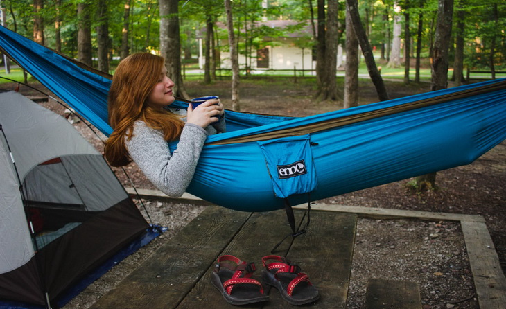 Woman relaxing in a Eno Eagles Nest Outfitters Double Nest Hammock