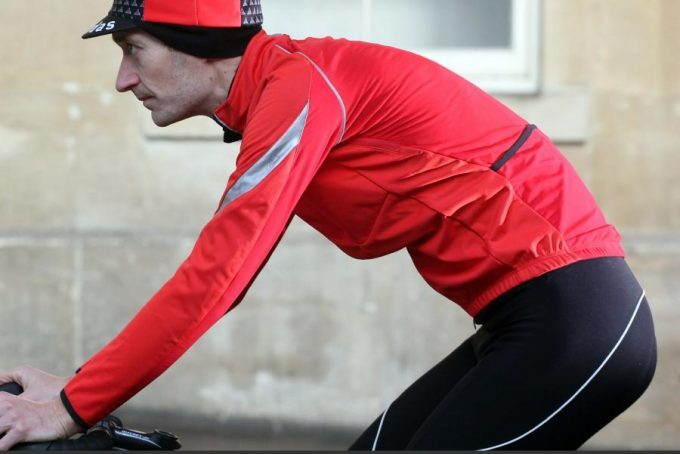 cyclist wearing SOFTSHELL dwr JACKET