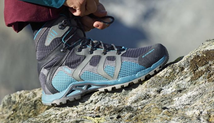Image of a woman with hands on her hiking boots