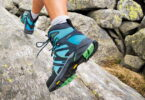 Image of a woman's legs wearing a pair of hiking boots