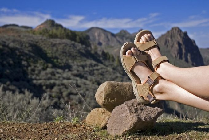 hikers legs with sandals on