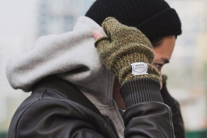man wearing figerless gloves