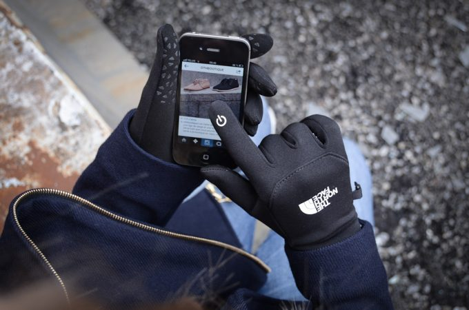 touching screen with woman winter gloves