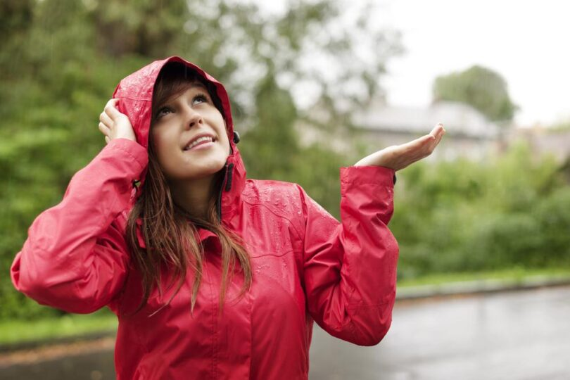 woman standing in the rain with jacket