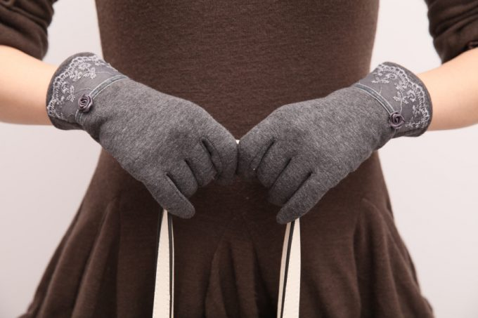 woman wearing fleece gloves