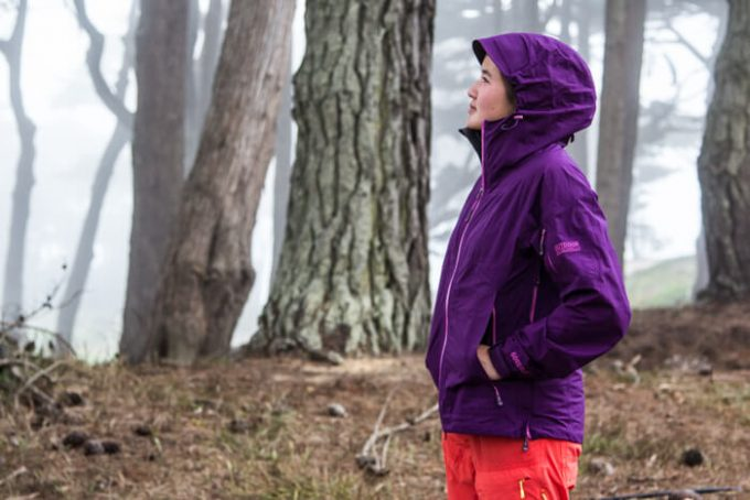 woman wearing rain jecket in forest