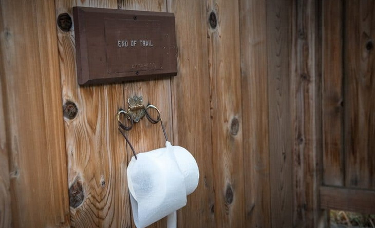 End of trail sign and toilet paper