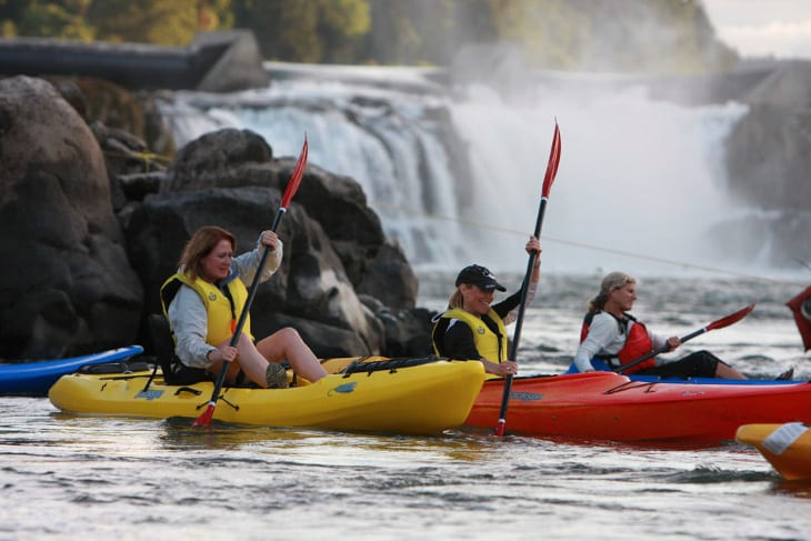 Kayaking with falls in background