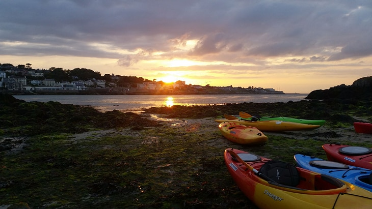 Kayaks under the sunset