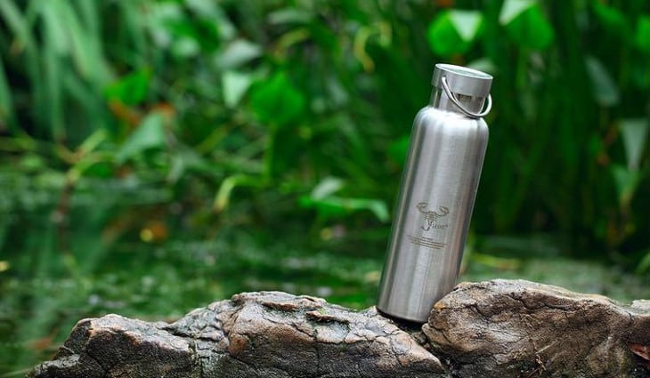 A stainless-steel-water-bottle in the nature