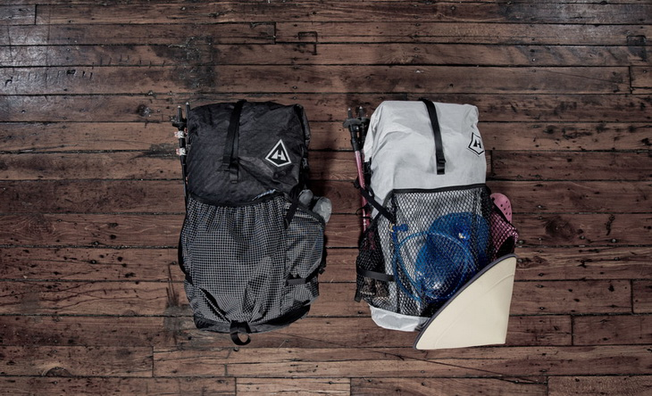 Two backpacks on a wooden floor