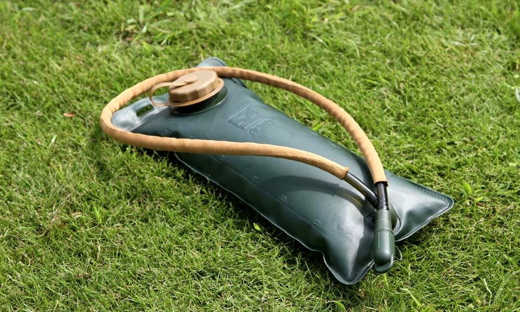 Water-bladder-for-hiking on the grass