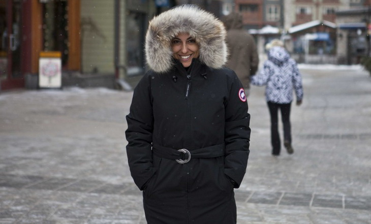 Woman wearing Canada Goose smilling at the camera