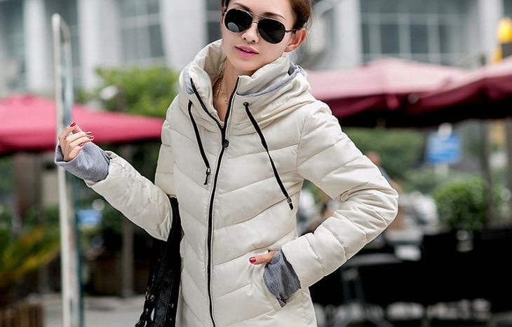 Woman wearing short white parka
