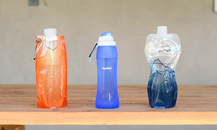 collapsible water bottles on a table