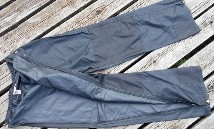 A pair of hiking pants on a wooden floor