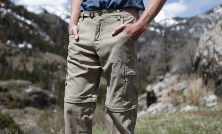 A man wearing a waterproof convertible hiking pants