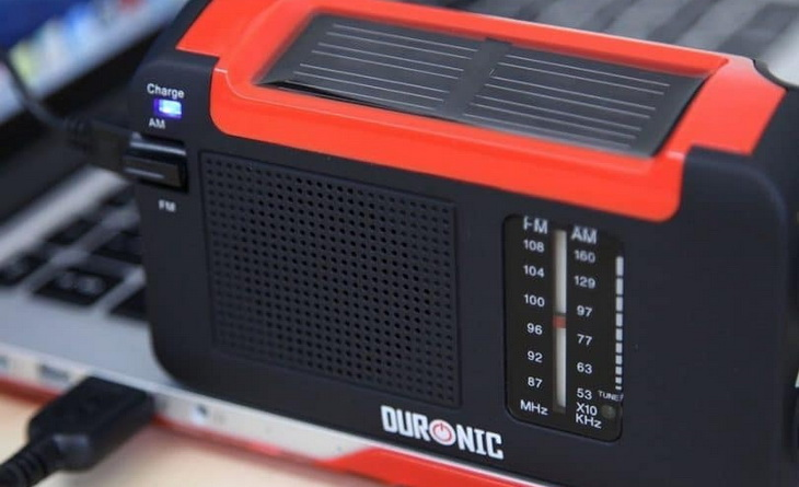 Duronic Hybrid solar charged radio sitting on a laptop