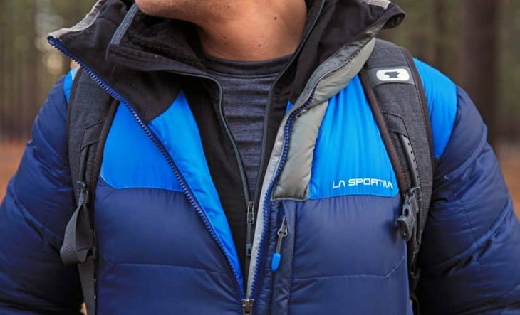 Close-up of a man wearing a LA Sportiva winter jacket