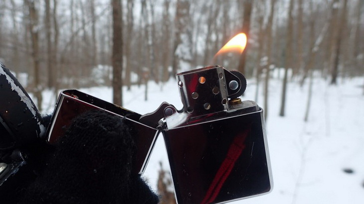 Flame of a windproof lighter in the winter time