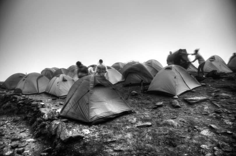 Setting up tents in rainy conditions