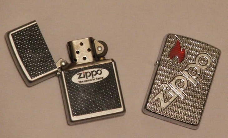 Two Zippo lighters on a table