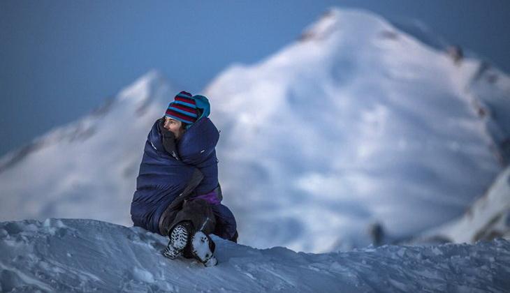 Woman sitting in a winter sleeping bag