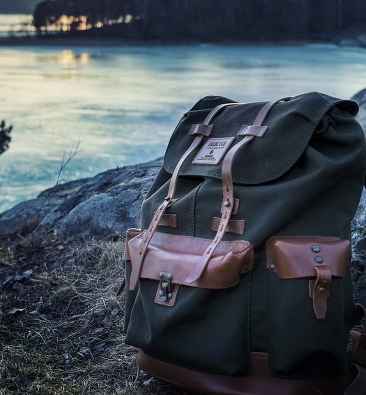 a daypack standing near a river