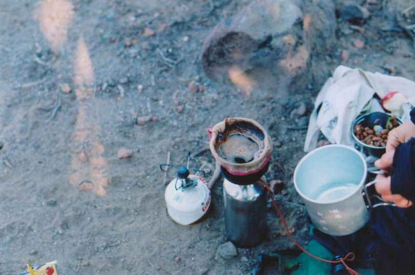 a picture of a man brewing coffee in the morning_files