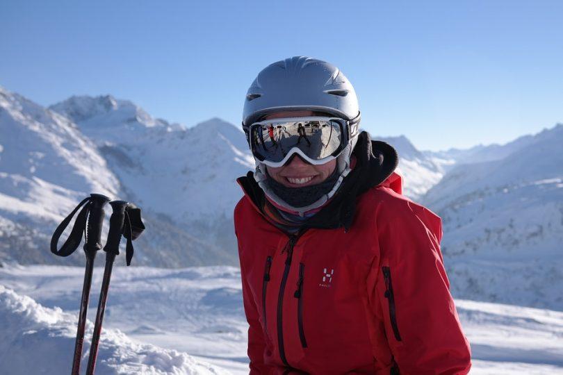 a ski runner smiling at the camera
