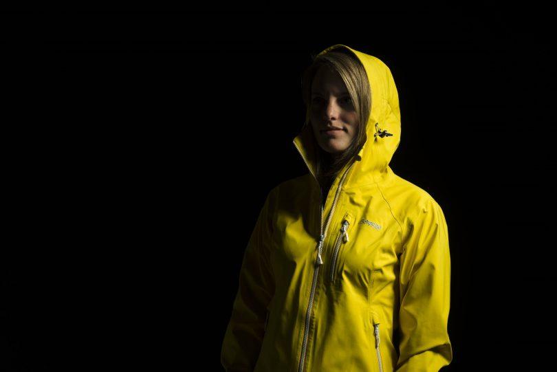 a woman wearing a hardshell jacket
