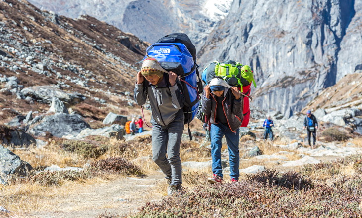Backpackers climbing the mountains