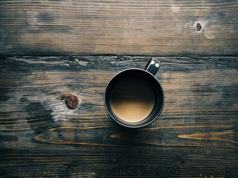picture of a cup of coffee sitting on a table