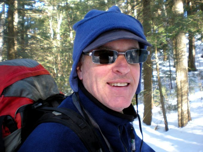 man-winter-hiking-wearing-a-hat-