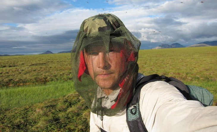 mean-wearing-insect-protection-hat-during-bug-season