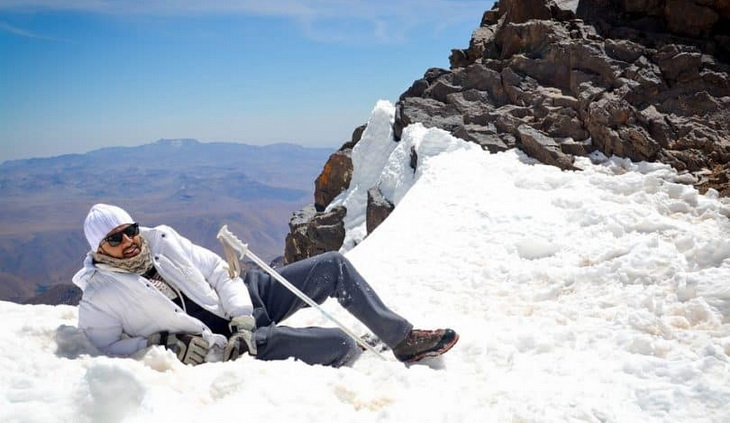 men-getting-rest-in-the-top-of-the-mountain