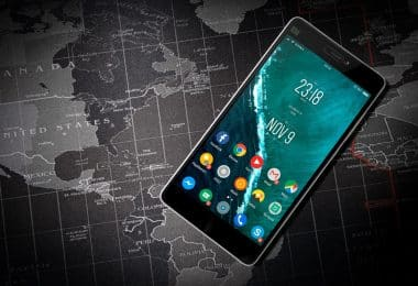 a photo of a mobile phone sitting on a map