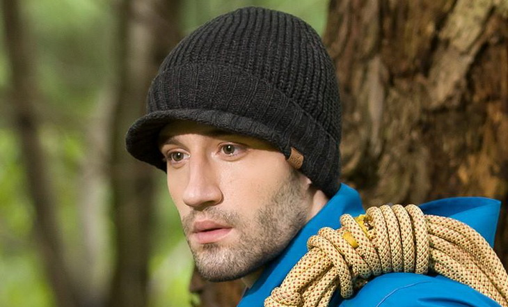 Man with a winter hiking hat
