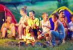 Kindergarten Kids Camping In The Forest Near Big Mountains