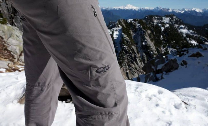 A man wearing a windproof hiking pants