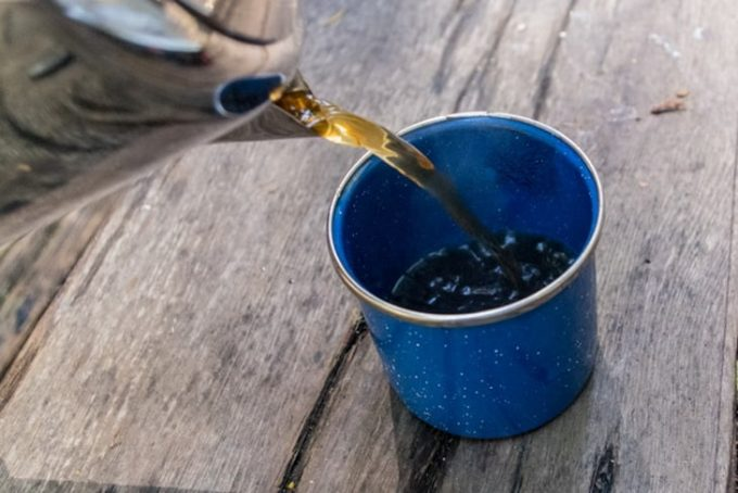 Image showing the cup of a camping thermos on a table