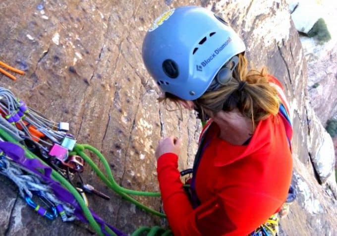 picture of a woman climbing the mountain